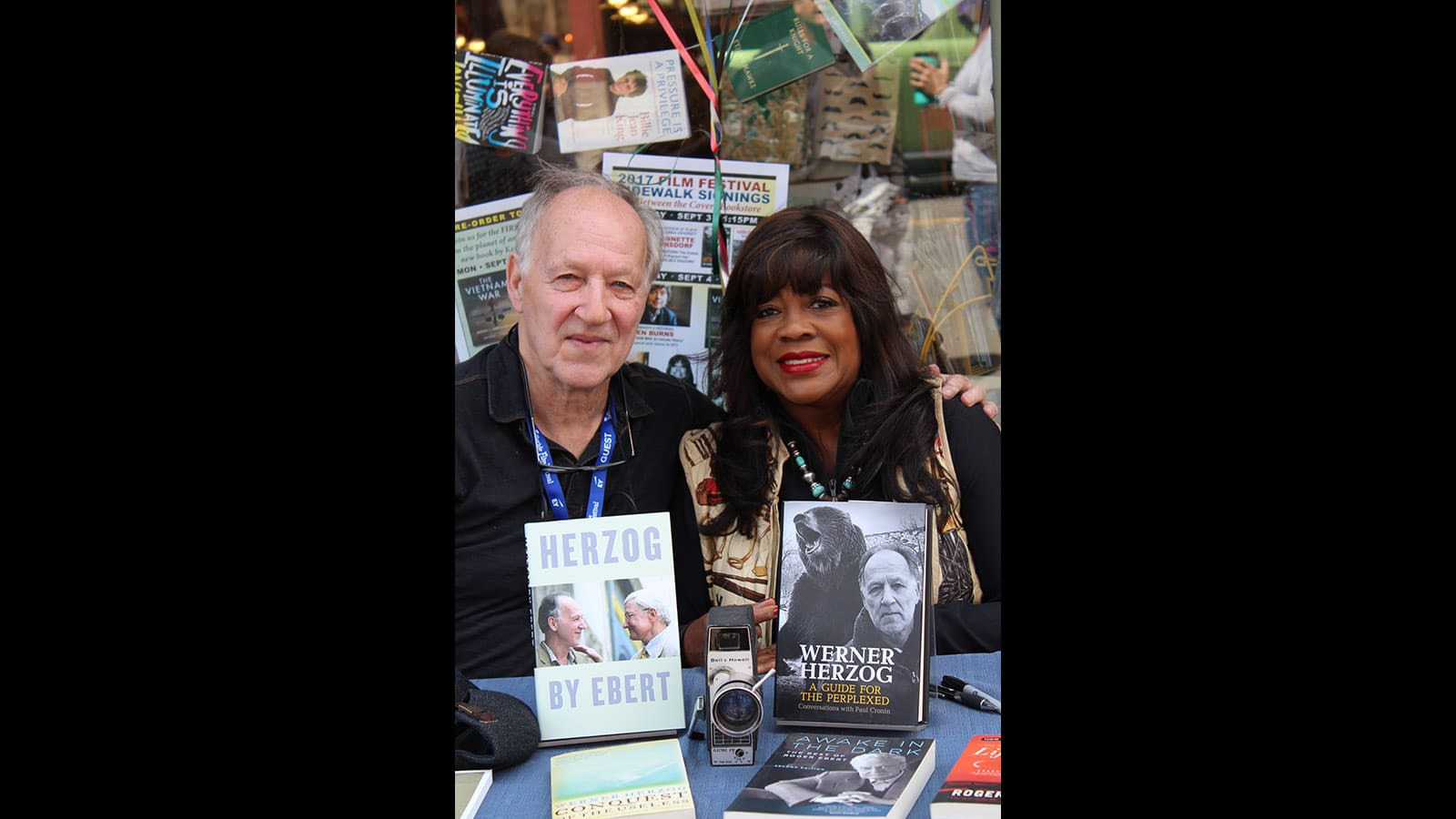 Werner Herzog and Chaz Ebert, wife of the late Roger Ebert, participate in a book signing on Telluride's main street.
